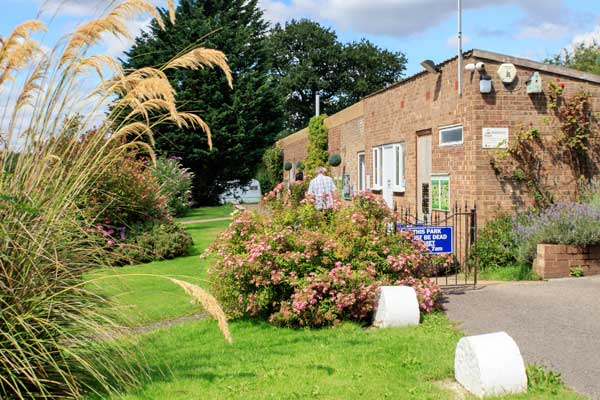 Beautifully tended Gardens around the Facilities Building at York Naburn Lock Caravan Park